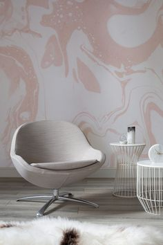 Understated luxury comes to mind when looking at this beautiful marbleized wallpaper design. Pink and white swirls help to create an intriguing yet artful design for your walls. Perfect for modern living room spaces.