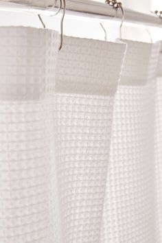 To keep things simple in the bathroom a white shower curtain can really keep things from feeling small in such a small space.