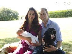 Happy family: Prince William and Duchess Kate, holding son George, relax with Tilly, a Middleton family pet, and Lupo, the couple's cocker spaniel.