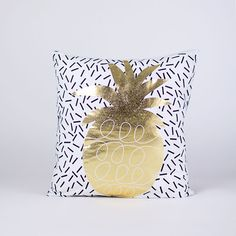 This pineapple pillow is the perfect addition to your summer home.