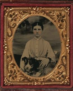 ca. 1860s, [hand tinted tintype portrait of a young lady holding a dog in her lap] via Harvard University, Houghton Library, Department of P...