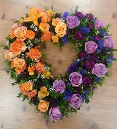 Orange and purple floral heart arrangement
