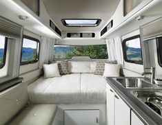 The new Airstream Nest features everything you need in a compact and lightweight fiberglass trailer, which can be towed by any car. Check out the Airstream Nest Floor plan and you'll see all the amenities in this mini airstream and camper.