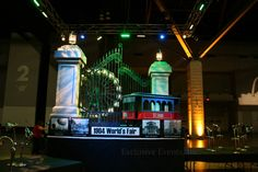 St. Louis Themed Centerpieces: The 1904 World's Fair Pavilion themed centerpiece featuring a trolley and ferris wheel, as well as photos from the actual 1904 Fair by Exclusive Events, Inc.