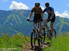 Biking on Emerald Mountain with the Steamboat Ski Resort in the background. Aug. 2011