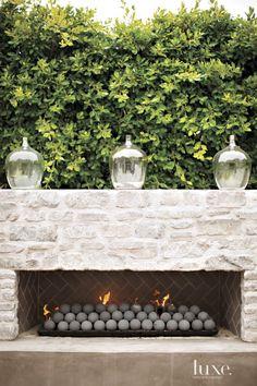 Chic patio features a pair of wicker sofas facing each other across from a weath…, – Modern brick fireplace Outdoor Fireplace Designs, Backyard Fireplace, Outdoor Fireplaces, Outdoor Wood Fireplace, Concrete Patios, Outdoor Rooms, Outdoor Living, Outdoor Decor, Outdoor Kitchens