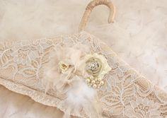 Bridal Hanger Wedding Dress Hanger in Ivory and Champagne with Pearls, Feathers and Lace- Vintage Desire. $90.00, via Etsy.