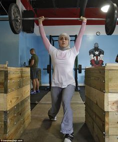 Muslim weightlifter fights rules that won't let her compete in a hijab - this should end any excuse you try and give about how you can't lift weights. If she can, you can.