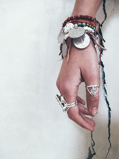 A very nice look of layered bracelets and rings for a Bohemian vibe.