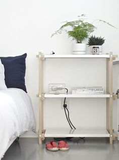 HAY | Woody shelves works as a practical bed side table.