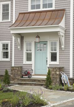 covered entry without impacting setback, turquoise door