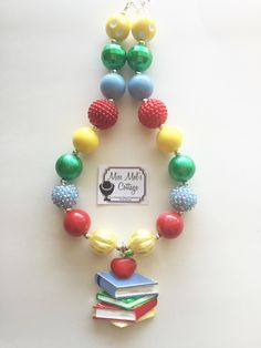A personal favorite from my Etsy shop https://www.etsy.com/listing/279382706/school-books-with-apple-chunky-bead