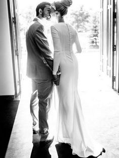 Long Sleeved Wedding Dresses: Plain Long sleeved dress with bow to the side and button down back | Bride's Dress Designer: Rosa Clara | Real Bride: Marta | Photography: Joel Bedford Photography