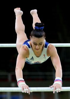 Claudia Fragapane of Great Britain practices on the uneven bars
