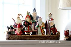I like how this collection of santas are displayed as a group in the basket: Savvy Southern Style