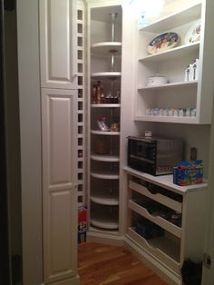 I like the lazy susan in the corner of the pantry, maximized storage!