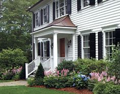 Curb appeal - how to do a garden bed close to the house: low & colour in front, medium height & evergreen in rear.