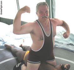 big wrestling man silverdaddie polarbear flexing arms
