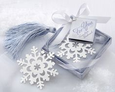 "It's winter, and you're curled up in your favorite chair next to a roaring fire with a cup of piping-hot chocolate close at hand, reading a best-seller as snow falls from the starry night sky.  Sounds like heaven, doesn't it? Your elegant wedding or dinner party guests will think so, too, when their stunning ""Snowflake "" Bookmark favor greets them at their table."