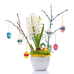 Flower arrangement with Easter eggs and white pearl hyacinth Stock Photo