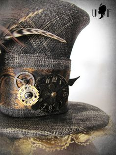 This is where I get confused by rather this is craft or art. It has a purpose and function, to be worn on the head, but the added elements make it art to me, gears, clock face, feathers, lace.     wellington/madhatter-hatt  steampunk. Check out http://www.designyourownperfume.co.uk to create your own custom fragrance to compliment your quirky Steampunk style...