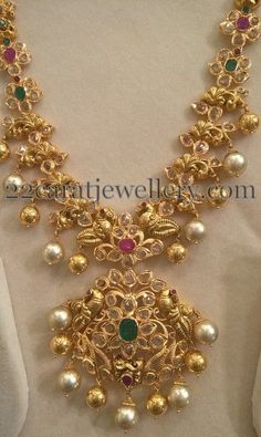 Floral clasps placed 22 carat gold uncut diamond medium size necklace with round flat diamonds and emeralds and rubies. Peacock design...
