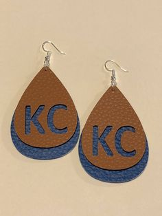 Excited to share the latest addition to our #etsy shop: KC/Royals leather earrings. Brown and Royals blue. KC cut out of the brown layer. Feel good about representing your team. http://etsy.me/2nJID8A #jewelry #earrings #brown #boho #earwire #women #earlobe #blue