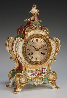 A Jacob Petit porcelain cased mantel clock, mid
