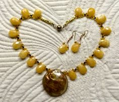 Yellow Calcite Briolette beads with Diochroic Glass Pendant.