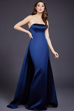 Fitted navy mermaid simple and fit evening dress with poly satin overlay and straight neckline and low back available in red and ivory.