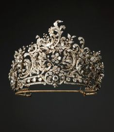 Made for Queen Charlotte, the second wife of the last Württemberg king, Wilhelm II (r. 1891-1918) by the Stuttgart court jeweler Eduard Foehr (1835-1904) in 1896 in the rococo style. Can be dismantled, and the sections worn as brooches or hair ornaments.