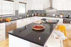 Black granite laminate island benchtop. Visit kaboodle.com.au for more inspiration!