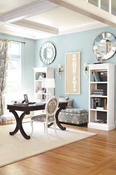 I am beginning to love blue and white.  I also love touches of dark brown which seem to ground the room.  This room would look very boring without the dark wood desk. {my future office}