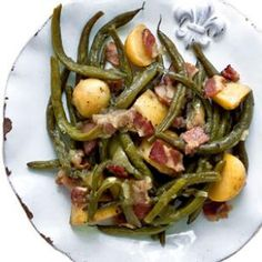 From chef Alex Patout of Landry's restaurant in New Iberia, Louisiana, we have a delicious recipe for Smothered Green Beans with New Potatoes. #healthy @EatingWell