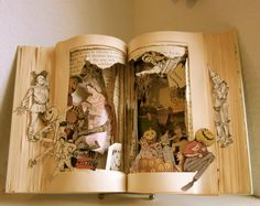 i really would love to do this but have no idea how to cut out the center of the pages.....so cool!
