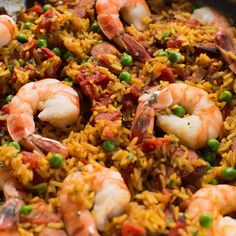 Feel like Spanish tonight? This paella recipe makes it easy with Zatarain's yellow rice, shrimp, smoked sausage, onion and peas. Fried Rice Recipe Video, Yellow Rice Recipes, Paella Recipe, Spanish Dishes, Shrimp Dishes, Free Recipes, Easy Recipes, Rice Meals, Main Dishes