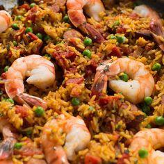 Feel like Spanish tonight? This paella recipe makes it easy with Zatarain's yellow rice, shrimp, smoked sausage, onion and peas. Fried Rice Recipe Video, Rice Recipes, Easy Recipes, Paella Recipe, Spanish Dishes, Shrimp Dishes, Main Dishes, Rice Meals, Seafood