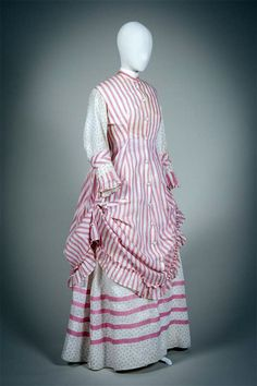 Day dress ca. 1873-75. Two pieces. White cotton gauze printed with pink polka dots and solid pink ribbon underskirt; pink & white striped overdress. Gemeentemuseum den Haag via Europeana Fashions