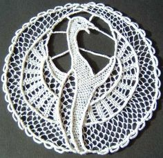 Bird in Needle Lace:  http://textiledreamer.wordpress.com/2007/02/24/more-needlepoint-lace/