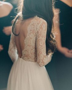 Winter wedding ideas: Long sleeve lace wedding dress with open back from Emma & Grace Bridal Studio. See more at emmaandgracebridal.com