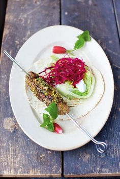 sizzling lamb koftas | Jamie Oliver | Food | Jamie Oliver (UK)  Ingredients ¼ of a red cabbage 2 tablespoons white wine vinegar 1 tablespoon caster sugar 50 g shelled pistachios 1 teaspoon fennel seeds ½ an iceberg lettuce 50 g stale bread 400 g minced lamb sweet chilli sauce 4 small tortillas 8 radishes fat-free natural yoghurt, to serve