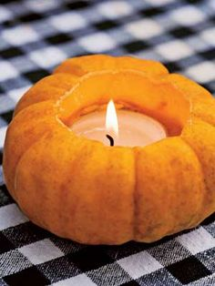 Pumpkin Votive: For an autumn table, carve out jack-be-little pumpkins and insert votive candles. This festive decoration can be used for Halloween parties, as well as Thanksgiving feasts.