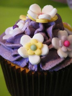 Purple frosting with small sugar flowers.