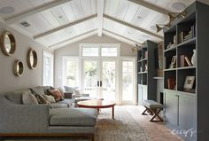 ideal family room - vaulted ceilings, modernized fireplace, with tv mounted above? could be best solution