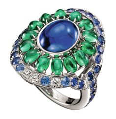 Capriccioli ring, set with an m'ai cabochon sapphire, paved with emeraid beads, blue and purpie sapphires and diamonds, on white gold