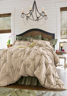 I'll take one of these bedspreads, and the light too, if you don't mind.