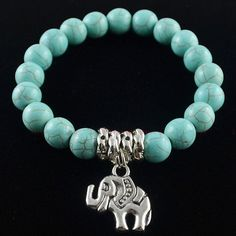 Tibetan Style Stretchy Turquoise And Silver Bracelet With Tibetan Elephant Charm
