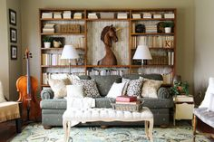 Warm & inviting living room makeover on a tight budget from Remodelaholic!