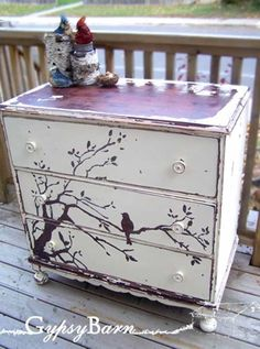 We've seen many examples lately of dressers getting dressed up using negative space to create playful images. This bird in a tree dresser is no exception. We love that the texture of the tree is actually real wood. What's different about this particular project, though, is how this look was achieved without busting out a single paintbrush.