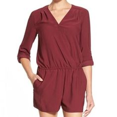 Trouvé Surplice Romper Trouvé Surplice Romper A gently gathered waist defines the relaxed silhouette of an airy romper styled with an elegant surplice neckline, roll-tab sleeves and leg-flaunting shorts. Color: BURGUNDY LONDON Trouve Dresses Long Sleeve
